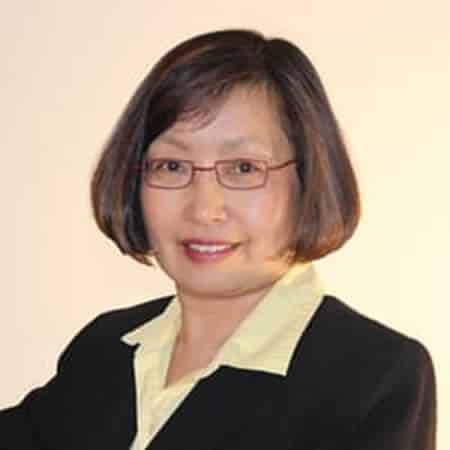 Dr. Nawei Jiang smiling with brown short hair and rectangular rimmed glasses